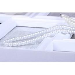 Fehér gyöngyökkel díszített nyakék. 00136ec